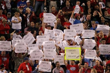 Fans of the Texas Rangers hold signs that read 'Shear the Beard' as seen behind home plate during Game Four against the San Francisco Giants during the 2010 MLB World Series...